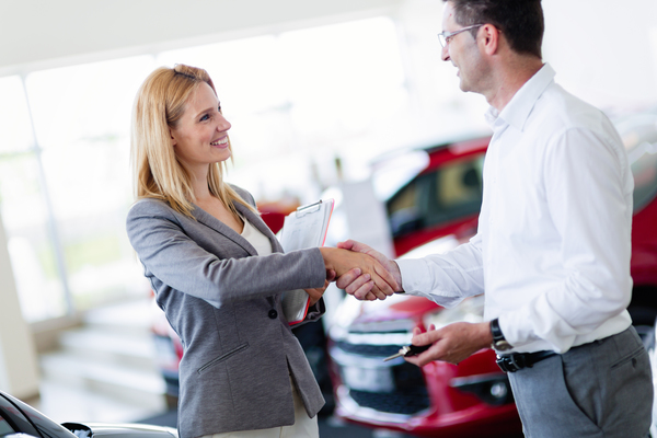 professional-salesperson-selling-cars-at-85KMCS6-1