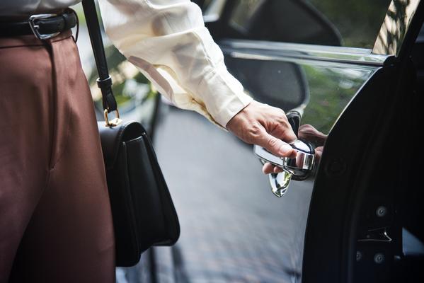 woman-getting-into-a-car-PA7FNDV-1